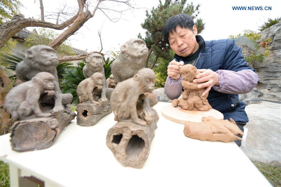 Guizhou, majom szobrász